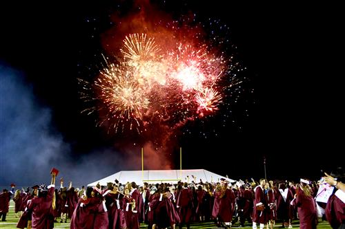 Fireworks in the sky, graduating students celebrating