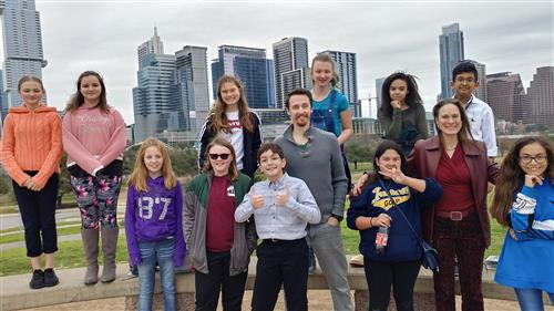 Students in front of downtown skyline