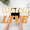 Watch LIVE written in Text in front of an ipdad